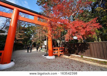 Tourists Visit Shimogamo Shrine Orange Archway In Kyoto, Japan