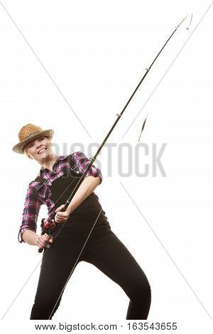 Spinning equipment angling cheerful fisherwoman concept. Happy woman in sun hat holding fishing rod having fun while hunting for fish