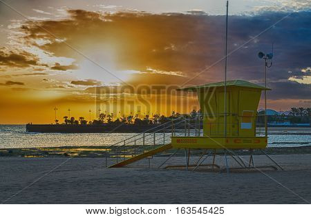 Relief post on the beach of Lanzarote Canary Islands at sunset
