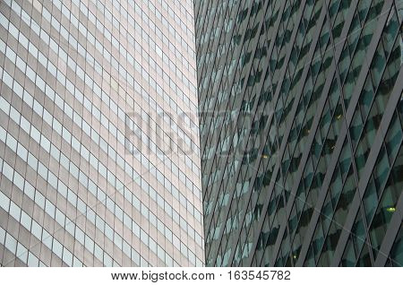 Midtown Manhattan NYC intersecting high-rise buildings architectural background
