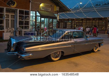 BANGKOK THAILAND - December 30 2016: Old vintage grey chevrolet car at Night market Srinakarin road that name is train market. This market is open every Wednesday to sunday.