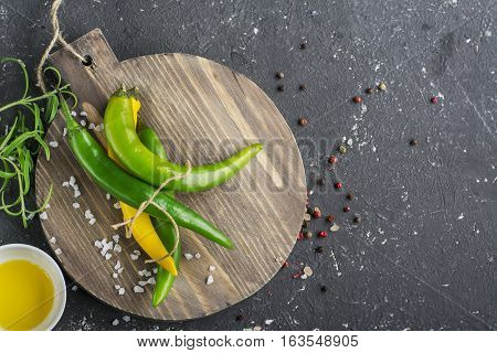 Ingredients vegetables, salt, spices, herbs for cooking homemade comfort food. Rosemary, salt and pepper on wooden cutting board, copy space. Cooking food background. Top view