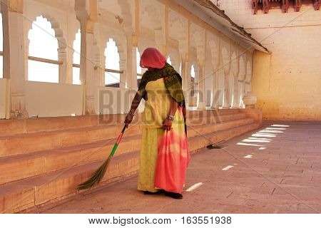 Jodhpur, India - February 11: An Unidentified Woman Sweeps Floor In Mehrangarh Fort On February 11,