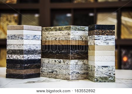Kitchen counter tops of granite marble and quartz, blurry background of granite kitchen countertops, assortment kitchen counters, countertop samples, granite counter colors, kitchen worktops on marble counter