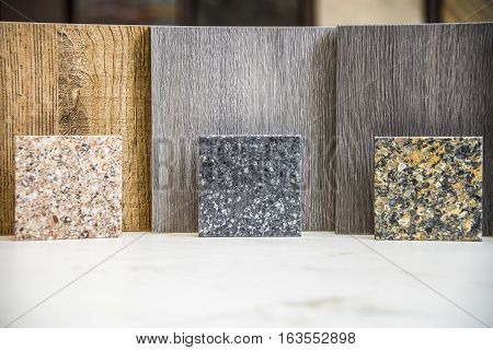 Three different color wood samples with complimenting kitchen or bath counter top block samples.