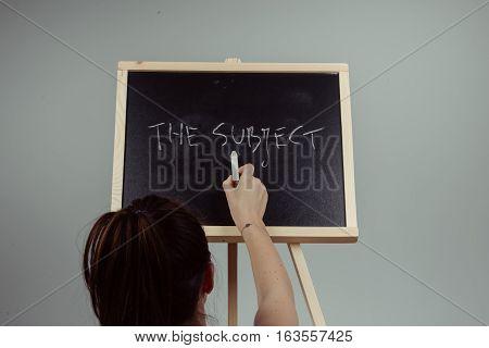 Subject Written In White Chalk On A Black Chalkboard