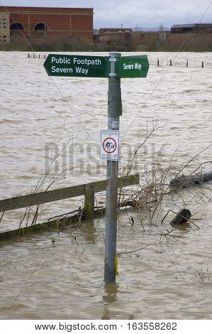 Severn Way Public Footpath under water as River Severn breaks its banks at Tewkesbury