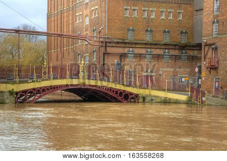 High water at Quay Street Bridge Decorated Iron bridge and Healings Flour Mill during Flood