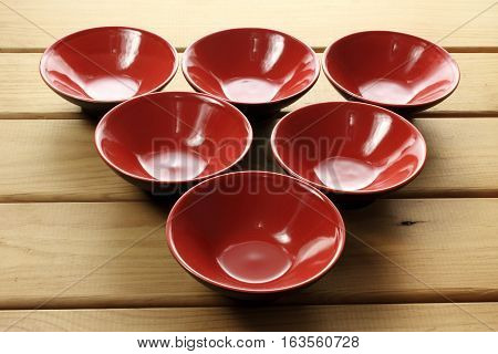Red Japanese Bowls on a Wooden Background