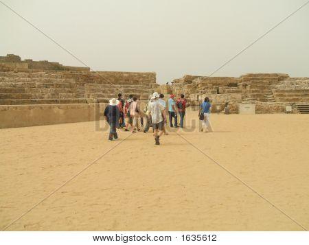 Tourists Leaving The Ancient Roman Theatre In Caesarea