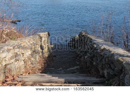 A man made walkway that leads to the rivers edge.