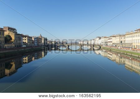 View of Ponte alla Carraia bridge on the Arno river in Florence, Italy