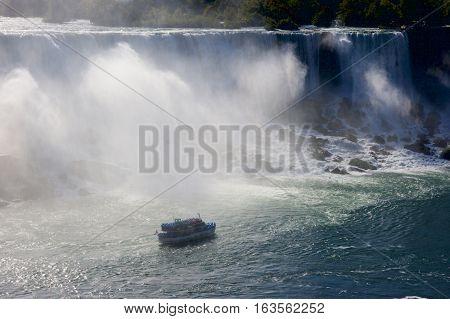 A tourist ferry boat beneath Niagara Falls, Ontario, Canada