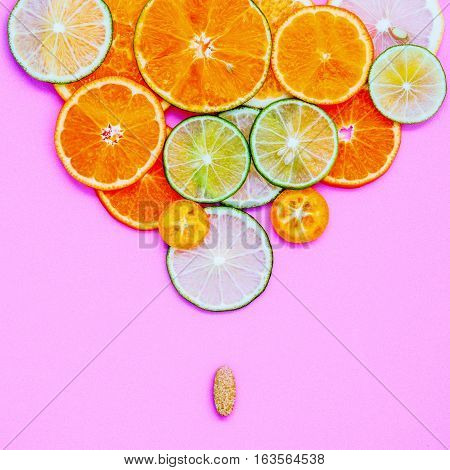 Healthy Foods And Medicine Concept. Pill Of Vitamin C And Various Citrus Fruits. Citrus Fruits Slice