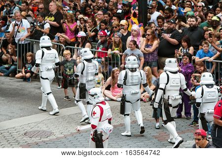 ATLANTA, GA - SEPTEMBER 2016:  People dressed as storm troopers from the Star Wars movies interact with a huge crowd gathered to watch the annual Dragon Con parade on Peachtree Street in Atlanta GA on September 3 2016.