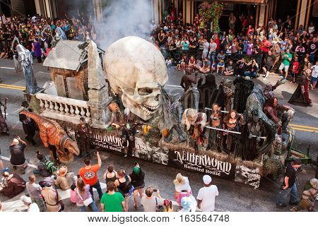 ATLANTA, GA - SEPTEMBER 2016:  A huge parade float with a giant human skull promotes a haunted house as it travels down the parade route of the annual Dragon Con parade in Atlanta GA on September 3 2016.