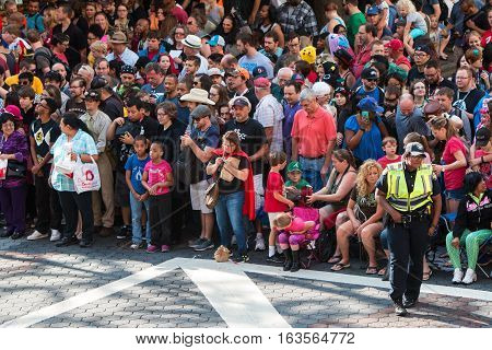 ATLANTA, GA - SEPTEMBER 2016: A huge crowd of spectators gathers on Peachtree Street in anticipation of the start of the annual Dragon Con parade Labor Day weekend in Atlanta GA on September 3 2016.