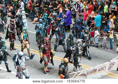 ATLANTA, GA - SEPTEMBER 2016:  People dressed like Mandalorian Mercs from the Star Wars movies walk along the parade route in the annual Dragon Con parade in Atlanta GA on September 3 2016.