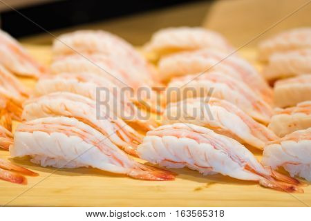 Close up of japanese culture food call nigiri sushi made with fresh shrimp topping on rice in local sushi restuarant ginza japan.