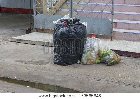 Pile of black garbage bag and Vegetable rot