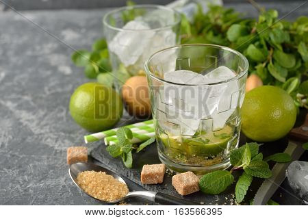 Ingredients for mojito on a gray background