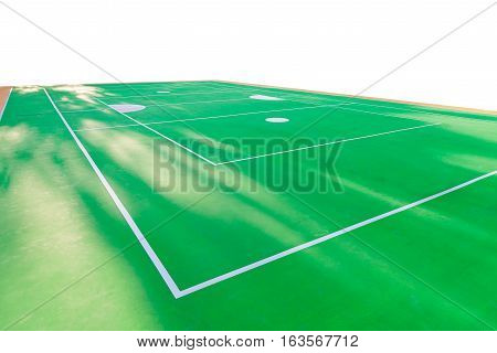 Empty rattan ball court with sunlight in summer. green court floor with white line.