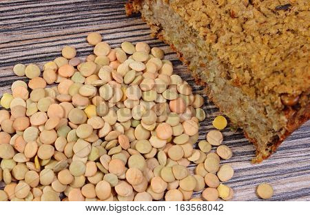 Heap Of Lentil And Homemade Pie On Wooden Background