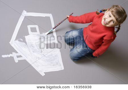 Little girl painting house