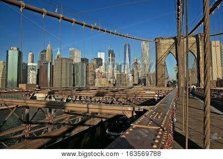 A view of Brooklyn Bridge against Manhattan skyline New York.