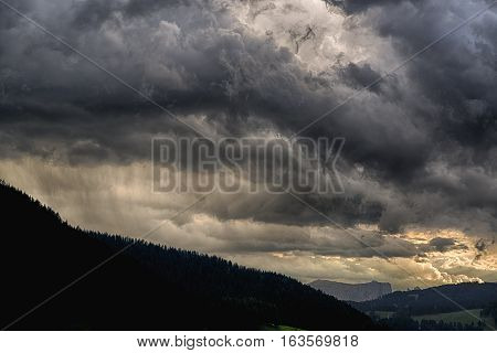 Thunderstorm over the Gardena Valley with Seiser Alm at the horizon at the sunset Trentino-Alto Adige