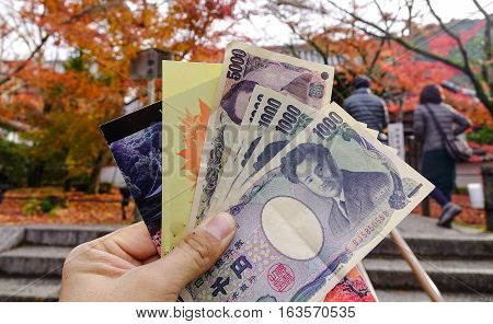 Hand Hold Banknotes At Autumn Garden