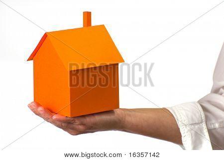 Orange house on hand