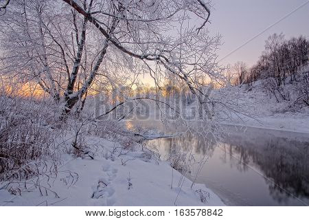 Winter sunrise on the river in the morning