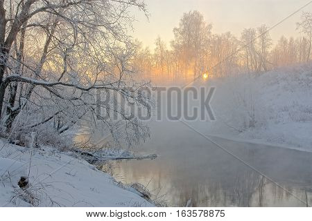 The sun's rays in a frosty morning on the river in the morning