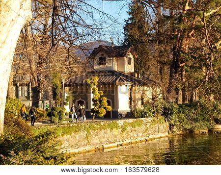 Lugano Switzerland - January 5 2015: Old Dock for access to the lake of the park Ciani oldest botanical garden. The park is famous and visited by many tourists every year.
