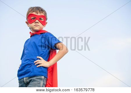 Happy Little Child Playing Superhero. Kid Having Fun Outdoors.