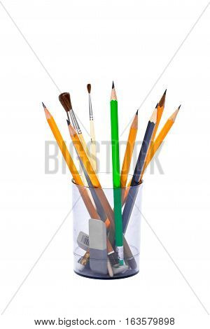 Office sets - pencils, brushes, rubber eraser in plastic glass