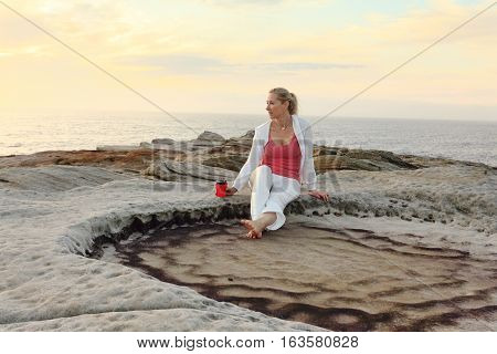 Carefree Woman Enjoys Morning Coffee