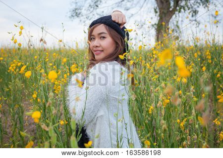 Beautiful asian woman in fields crotalaria Thailand