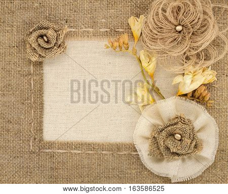 The framework is made of burlap and roses with space for text