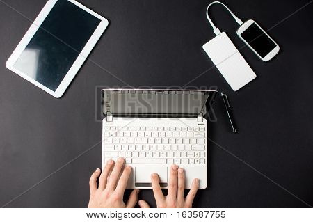 Male Hands Typing On A White Lap Top