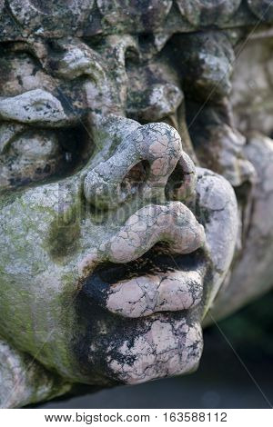 Beautiful Close Up Portrait Image Of Whimsical Gargoyle On Medieval Fountain Sculpture