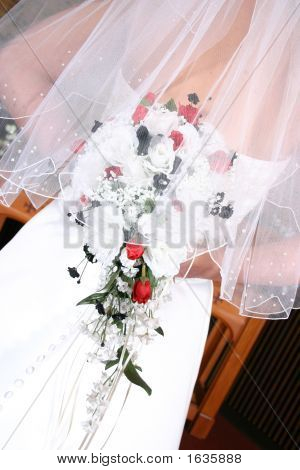 Back View Of A Wedding Dress, Bride Holding Flowers