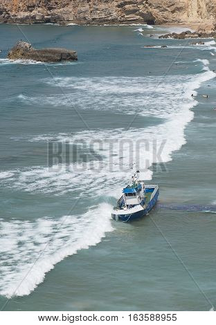 fishing boat ran aground near the beach in Portugal
