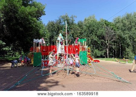 Nizhny Novgorod, Russia. - August 01.2016. Children playground game complex in Kulibina park - sports equipment of the strung ropes for climbing