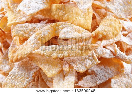 Angel wings (Faworki) are a traditional sweet crisp pastry made out of dough that has been shaped into thin twisted ribbons deep-fried and sprinkled with powdered sugar to celebrate Fat Thursday or Mardi Gras.