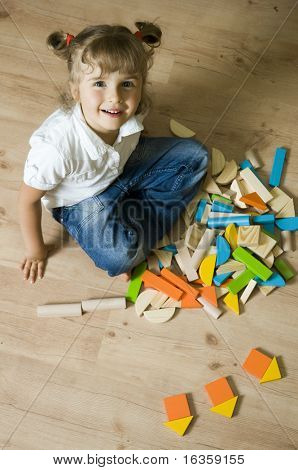 Cute girl playing with blocks