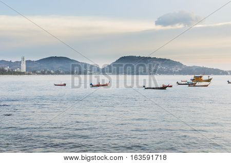 Patong beach on twilight cloudy Phuket Thailand. It is well-known destination for tourists all over the world.