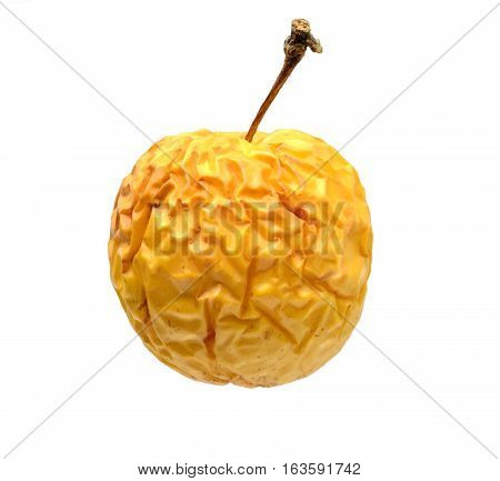 wrinkled yellow apple isolated on white background