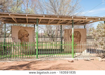 KOFFIEFONTEIN SOUTH AFRICA - DECEMBER 24 2016: Historic murals by Italian war prisoners in Koffiefontein (coffee fountain). One painting depicts Italian dictator Benito Mussolini